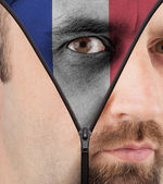 Unzipping face to flag of France — Stock Photo