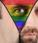 Unzipping face to rainbow flag — Stock Photo
