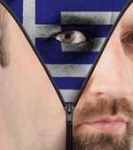 Unzipping face to flag of Greece — Stock Photo