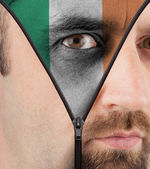 Unzipping face to flag of Ireland — Stock Photo