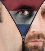 Unzipping face to flag of the Netherlands — Stock Photo