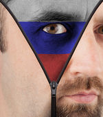 Unzipping face to flag of Russia — Stock Photo