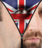 Unzipping face to flag of England — Stock Photo