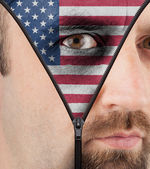 Unzipping face to show flag of USA — Stock Photo