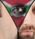 Unzipping face to flag of Burundi — Stock Photo