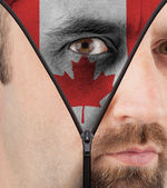 Unzipping face to flag of Canada — Stock Photo