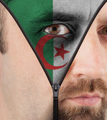 Unzipping face to flag of Algeria — Stock Photo