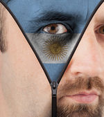 Unzipping face to flag of Argentina — Stock Photo