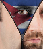 Unzipping face to flag of Cuba — Stock Photo