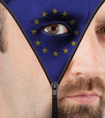 Unzipping face to flag of the EU — Stock Photo