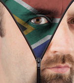 Unzipping face to flag of South Africa — Stock Photo
