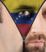 Unzipping face to flag of Venezuela — Stock Photo