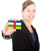 Business woman holding a card with the flag of Central African R — Stockfoto