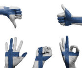 Hand set with the flag of FInland — Stock fotografie