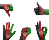 Hand set with the flag of Afghanistan — Stock Photo