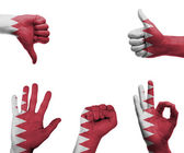 Hand set with the flag of Bahrain — Stock Photo