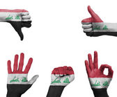 Hand set with the flag of Iraq — Stock Photo