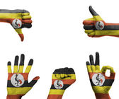 Hand set with the flag of Uganda — Stock Photo