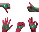 Hand set with the flag of Maldives — Stock Photo