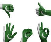 Hand legen mit der flagge von pakistan — Stockfoto