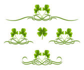 Elements in vintage style with clover leafs. Symmetric inward — Stock Vector