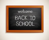Back to school written on blackboard — Stock Vector