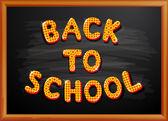 Zpátky do školy napsaný na tabuli — Stock vektor