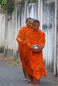 Young monks going to the offering food in Thailand — Stock Photo
