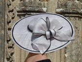 Elegant grey hat with large node — Stock Photo