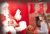 Santa claus and beautiful little girl — Stock Photo