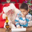 Santa claus and little boy — Stock Photo