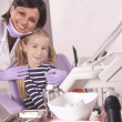 Dentist and patient in dental office — Stockfoto