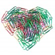 Royalty-Free Stock Photo: Multi color paper clips arranged in heart shape.