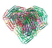 Multi color paper clips arranged in heart shape. — Stock Photo