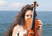 Young female girl holding a violin. — Stock Photo