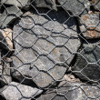 Stock Photo: Stone and barbed wire.