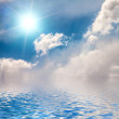 Sky and sun reflected in water. — Stock Photo #27478873