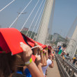 "VLADIVOSTOK, RUSSIA - JULY 7: Flashmob ""I love Vladivostok"" on the ""Golden Bridge"". — Stock Photo"