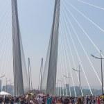 "VLADIVOSTOK, RUSSIA - JULY 7: Flashmob ""I love Vladivostok"" on the ""Golden Bridge"". — Stock Photo #27765509"
