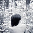 Young woman in forest, view from the back. — Stock Photo