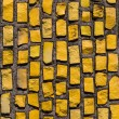 Wall with yellow stone rock. — Stock Photo