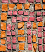 Wall with orange and pink stone rock. — Stock Photo