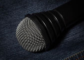 Jeans and microphone. — Stock Photo
