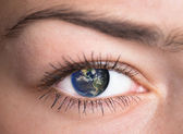 Eye with the earth inside. — Stock Photo