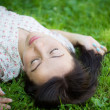 Young woman lying on the grass. — Stock Photo #41541011