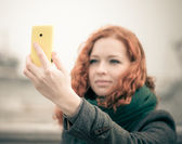 Young girl taking a selfie. — Stock Photo