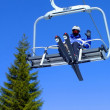 Skier on a ski lift — Stock Photo