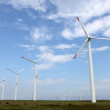 Stock Photo: Wind turbine producing alternative energy