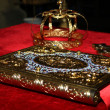 Crosses , rings and crowns of gold on table in church.Wedding celebration — Stock Photo #13392492