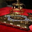 Stock Photo: Crosses , rings and crowns of gold on table in church.Wedding celebration